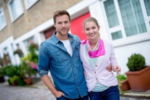 Couple buying a house and looking very happy