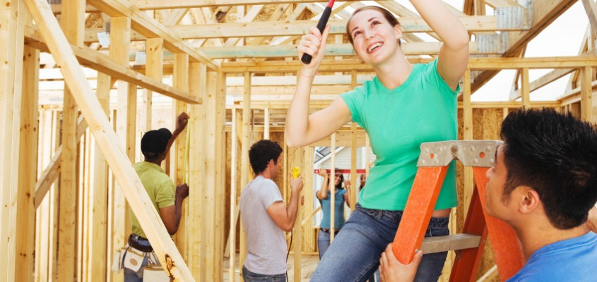 Volunteer group working on new home construction